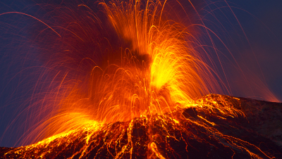 erupting valcano shooting lava, debris, gas and more into the air.